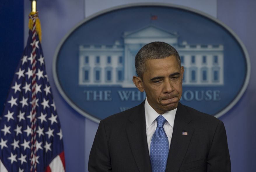 ** FILE ** President Obama pauses as he speaks at the daily news briefing at the White House in Washington on Friday, July 19, 2013. (AP Photo/Carolyn Kaster)