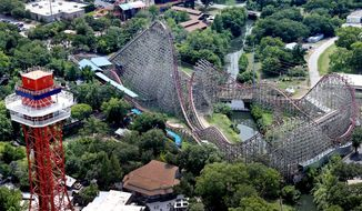 A woman fell to her death from the Texas Giant roller coaster at Six Flags Over Texas on Friday, July 19, 2013, in Arlington, Texas. The odds of being killed while on an amusement park ride: 1 in 750 million. (AP Photo/The Dallas Morning News, Louis DeLuca)