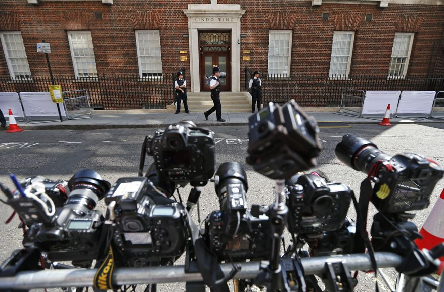 Remote-controlled cameras are set up across St. Mary's Hospital exclusive Lindo Wing in London, Monday, July 22, 2013. Buckingham Palace officials say Prince William's wife, Kate, has been admitted to the hospital in the early stages of labour.  Royal officials said that Kate traveled by car to St. Mary's Hospital in central London. Kate _ also known as the Duchess of Cambridge _ is expected to give birth in the private Lindo Wing of the hospital, where Princess Diana gave birth to William and his younger brother, Prince Harry. The baby will be third in line for the British throne _ behind Prince Charles and William _ and is anticipated eventually to become king or queen. (AP Photo/Lefteris Pitarakis)