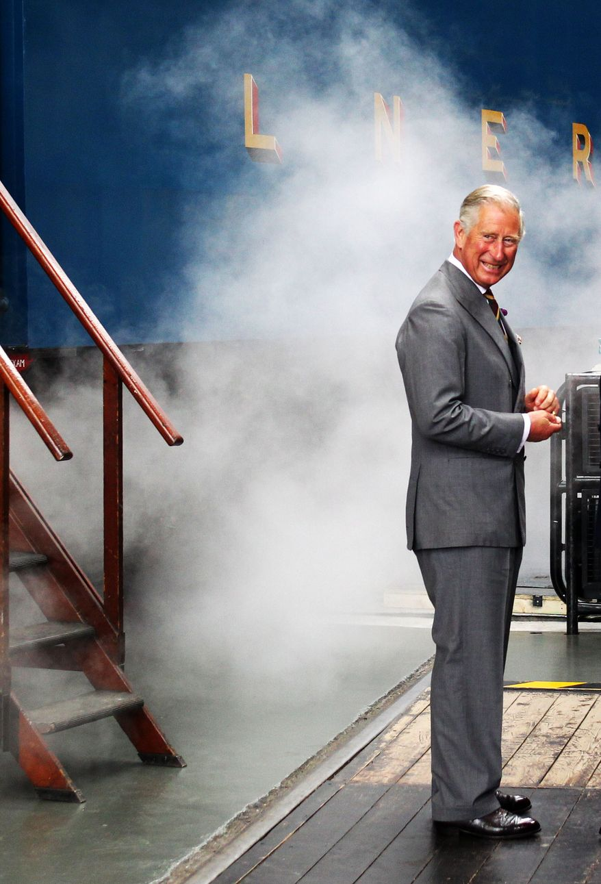 Britain's Prince Charles arrives on the Bittern steam locomotive as he visits the National Railway Museum in York, Britain, Monday, July 22, 2013. Prince William's wife, Kate, is in the early stages of labor in a private wing of a central London hospital, palace officials said Monday. It is a historic moment for the British monarchy — the couple's first child will become third in line for the British throne, after Prince Charles and William, and should eventually become king or queen. (AP Photo/PA, Lynne Cameron) UNITED KINGDOM OUT, NO SALES, NO ARCHIVE