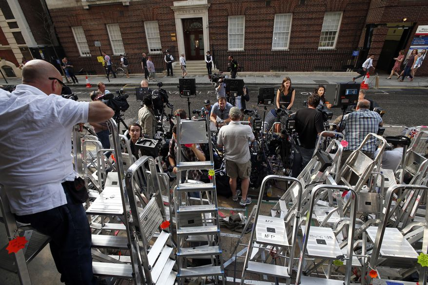 Members of the media gather across St. Mary's Hospital exclusive Lindo Wing in London, Monday, July 22, 2013. Buckingham Palace officials say Prince William's wife, Kate, has been admitted to the hospital in the early stages of labour. Royal officials said that Kate traveled by car to St. Mary's Hospital in central London. Kate _ also known as the Duchess of Cambridge _ is expected to give birth in the private Lindo Wing of the hospital, where Princess Diana gave birth to William and his younger brother, Prince Harry.The baby will be third in line for the British throne _ behind Prince Charles and William _ and is anticipated eventually to become king or queen. (AP Photo/Lefteris Pitarakis)
