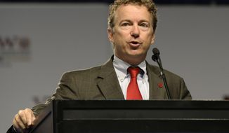 ** FILE ** Sen. Rand Paul, Kentucky Republican, addresses the 114th annual national convention of the Veterans of Foreign Wars on Monday, July 22, 2013, at the Kentucky International Convention Center in Louisville, Ky. (AP Photo/Timothy D. Easley)