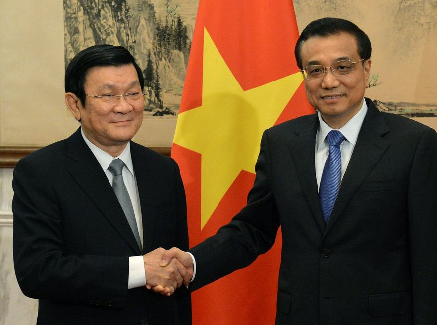 Vietnamese President Truong Tan Sang (left, shown here with Chinese Premier Li Keqiang in June) will meet with President Obama while suppressing dissidents, bloggers and religious leaders. (AP Photo/Mark Ralston, Pool)