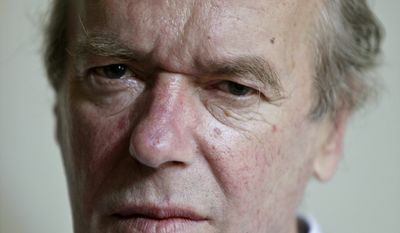 British novelist Martin Amis (shown here in 2012) appeared with fellow novelists and old friends Ian McEwan and Salman Rushdie in New York on Monday. (AP Photo/Bebeto Matthews,File)