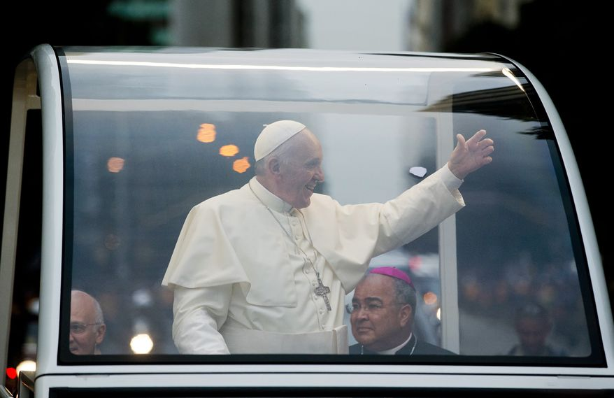Pope Francis waves as he rides in his popemobile in Rio de Janeiro, Brazil, Monday July 22, 2013. The pontiff arrived for a seven-day visit in Brazil, the world's most populous Roman Catholic nation. During his visit, Francis will meet with legions of young Roman Catholics converging on Rio for the church's World Youth Day festival. (AP Photo/Victor R. Caivano)