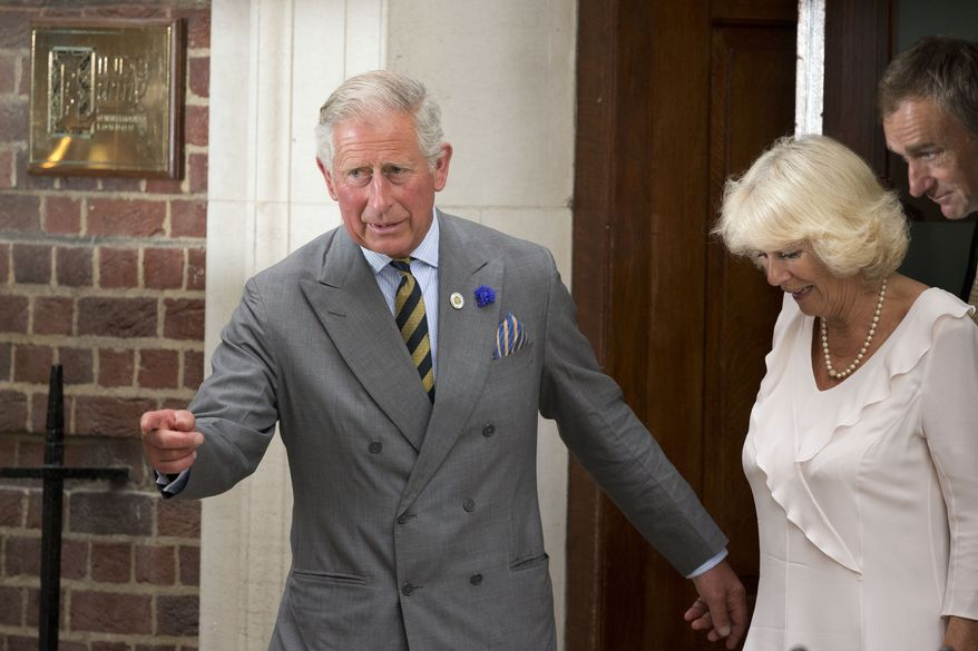 Britain's Prince Charles and his wife, Camila, Duchess of Cornwall, depart on July 23, 2013, St. Mary's Hospital exclusive Lindo Wing in London, where Kate, Duchess of Cambridge, gave birth to a baby boy on July 22. The Royal couple are expected to head to London's Kensington Palace from the hospital with their newly born son, the third in line to the British throne. (Associated Press)