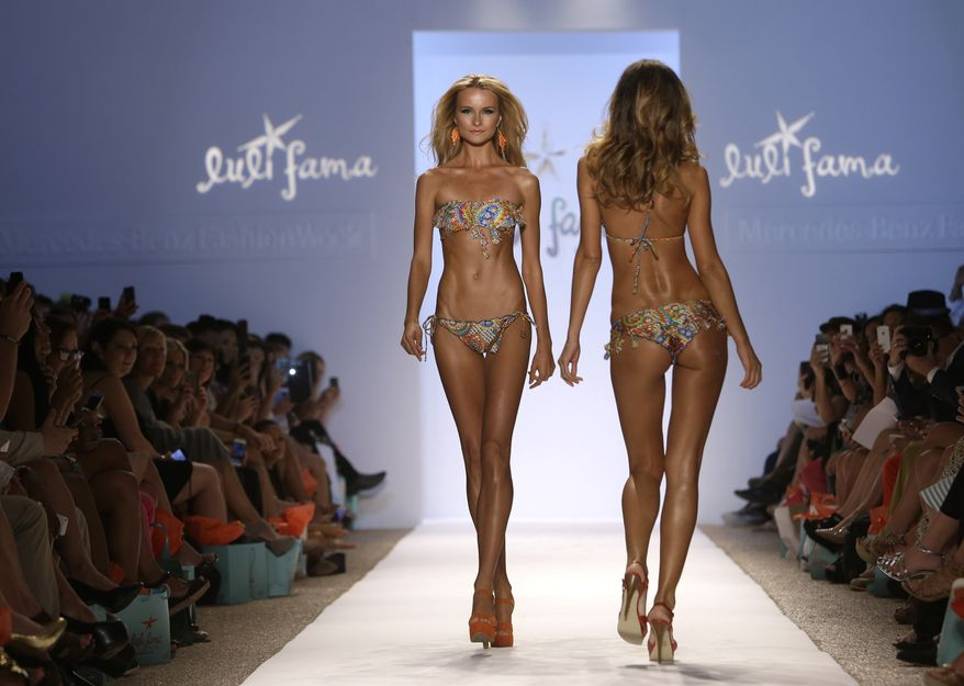 Models walks the runway during the Luli Fama show at Mercedes-Benz Fashion Week Swim, Sunday, July 21, 2013, in Miami Beach, Fla. (AP Photo/Lynne Sladky)