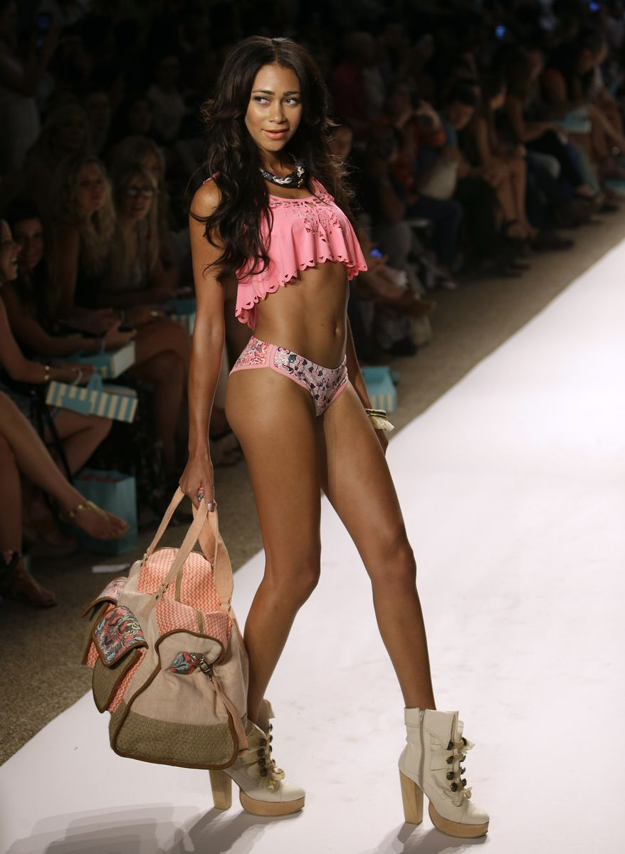 A model walks the runway during the Maaji show at Mercedes-Benz Fashion Week Swim, Sunday, July 21, 2013, in Miami Beach, Fla. (AP Photo/Lynne Sladky)