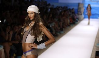 A model walks the runway during the Maaji show at the Mercedes-Benz Fashion Week Swim, Sunday, July 21, 2013, in Miami Beach, Fla. (AP Photo/Lynne Sladky)