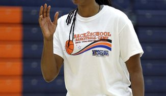"""Former WNBA star and Olympic gold medalist Chamique Holdsclaw takes part in a youth basketball clinic Tuesday, July 23, 2013, in Hendersonville, Tenn. Holdsclaw said she's getting her life back in order after a few months that felt like a """"mental prison"""" after an arrest last November. (AP Photo/Mark Humphrey)"""