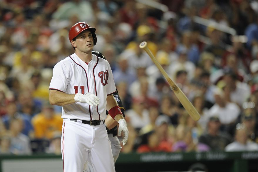 Ryan Zimmerman tosses his bat after striking out to end the sixth inning in the Nationals' loss. (Associated Press photo)
