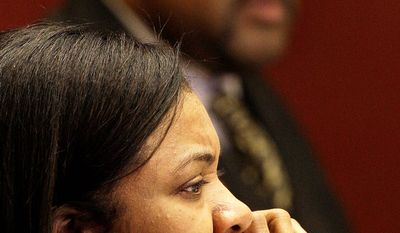 """Detroit City Council President Pro Tem Monica Conyers, foreground is shown  in a council meetin with Council President Ken Cockrel Jr., background, in Detroit, Tuesday, Sept. 9, 2008. Conyers, the wife of a one of the nation's most powerful congressmen, John Conyers, and one of the most volatile and unpredictable elected leaders in Detroit. She has been accused of threatening to shoot a mayoral staffer and publicly called the city council president, and now incoming mayor, """"Shrek."""" In less than two weeks, she takes over as Detroit City Council president when Ken Cockrel Jr. moves up to the mayor's office, replacing the disgraced Kwame Kilpatrick.  (AP Photo/Paul Sancya)"""