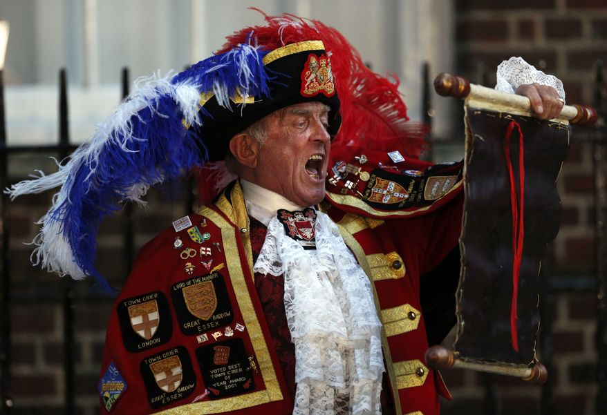 Tony Appleton, a town crier, announces the birth of the royal baby, outside St. Mary's Hospital exclusive Lindo Wing in London on Monday. (AP Photo/Lefteris Pitarakis, File)