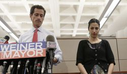 Then-New York mayoral candidate Anthony Weiner speaks during a news conference alongside his wife, Huma Abedin, at the Gay Men's Health Crisis headquarters on Tuesday, July 23, 2013, in New York. (AP Photo/Kathy Willens) ** FILE **