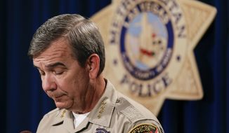 Clark County Sheriff Doug Gillespie gives details about the death of Las Vegas Metropolitan search and rescue police officer David Vanbuskirk during a news conference, Tuesday, July 23, 2013, in Las Vegas. Vanbuskirk fell to his death Monday night while rescuing a hiker who was stranded in a forbidden area of Mount Charleston northwest of the city. (AP Photo/Julie Jacobson)