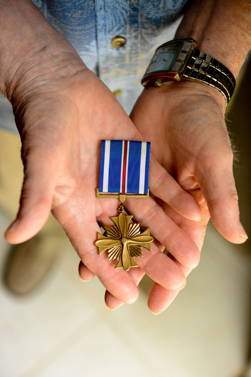 "World War II bomber pilot veteran Millard ""Lefty"" Palmer has received a Distinguished Flying Cross with Valor from Rep. Gerry Connolly (D-Va.), Fairfax, Va., Tuesday, July 23, 2013. (Andrew Harnik/The Washington Times)"