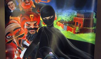 Wonder Woman and Supergirl now have a Pakistani counterpart in the pantheon of female superheroes. Meet Burka Avenger: a mild-mannered teacher with secret martial arts skills who uses a flowing black burka to hide her identity as she fights local thugs seeking to shut down the girls' school where she works. (AP Photo/Anjum Naveed)