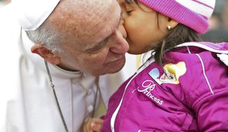 Pope Francis kisses a child as he arrives in his popemobile to the Aparecida basilica in Aparecida, Brazil, Wednesday, July 24, 2013. Tens of thousands of faithful flocked to the tiny town of Aparecida, tucked into an agricultural region halfway between Rio de Janeiro and Sao Paulo, where he is to celebrate the first public Mass of his trip in a massive basilica dedicated to the nation's patron saint. (AP Photo/Victor R. Caivano)