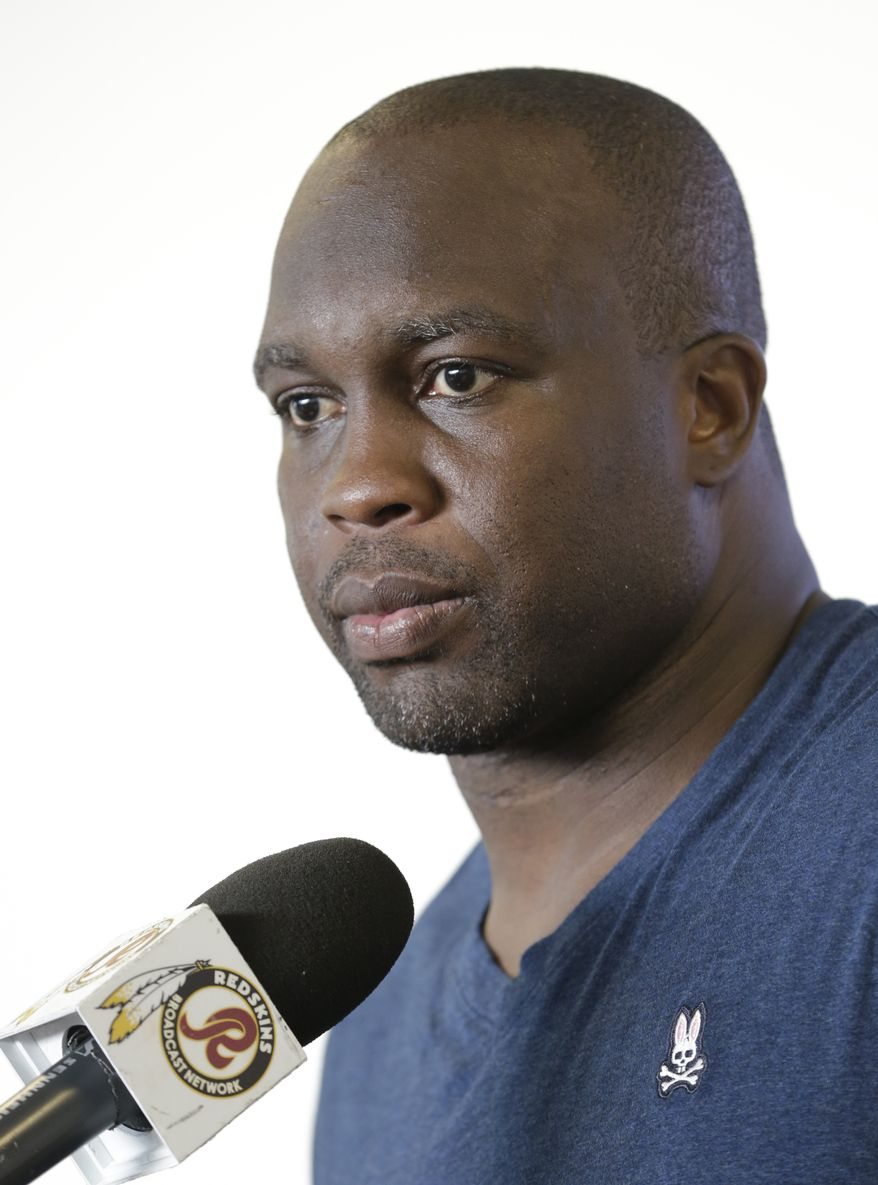 Washington Redskins linebacker London Fletcher answers reporters questions during a news conference at the new training facility in Richmond, Va. Wednesday, July 24, 2013. (AP Photo/Steve Helber)