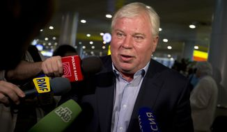 ** FILE ** Russian lawyer Anatoly Kucherena speaks to the media at Sheremetyevo Airport outside Moscow on Friday, July 12, 2013. (AP Photo/Alexander Zemlianichenko)