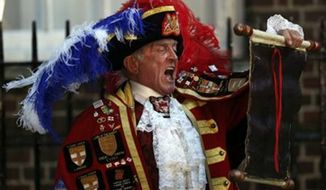 ** FILE **  Tony Appleton, a town crier, announces the birth of the royal baby, outside St. Mary's Hospital exclusive Lindo Wing in London, July 22, 2013. Well-wishers waiting outside St. Mary's Hospital in London might have been forgiven for thinking Appleton had the royal seal of approval. Appleton is in fact a crier, but in Romford, a commuter town just east of London, and in Bury St. Edmunds, a market town in southeastern England, not Buckingham Palace. (Associated Press)