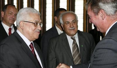 ** FILE ** Palestinian President Mahmoud Abbas (left) greets Jean Asselborn (right), Luxembourg's foreign minister, as Riyad Mansour, Palestinian observer to the United Nations, looks on during a summit on the Millennium Development Goals at United Nations headquarters in New York on Tuesday, Sept. 21, 2010. (AP Photo/David Karp)