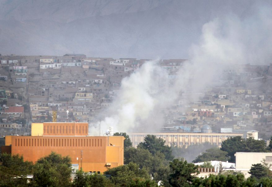 Afghan security forces patrol near the building that was occupied by militants in Kabul in September 2011. Insurgent took over a building to fire on the U.S. Embassy and NATO compounds. An internal report revealed the U.S. diplomatic facilities in Afghanistan have dangerous security lapses. (Associated Press)