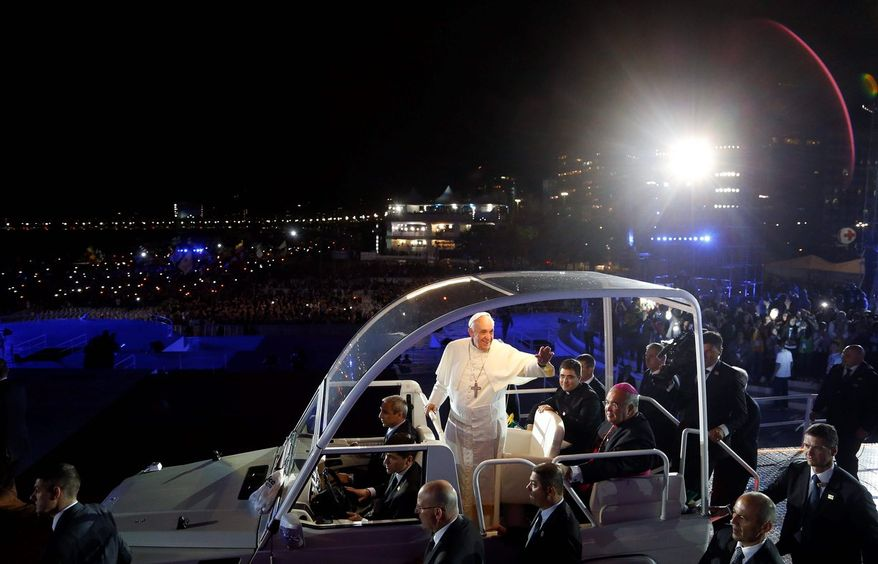 Pilgrims from 175 nations cheer as Pope Francis arrives Thursday in Rio de Janeiro. World Youth Day pilgrims, studies show, are more likely to be devout in an increasingly secularized world. (Associated Press)