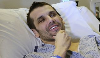 ** FILE ** Marc Fucarile smiles while speaking with reporters at the Massachusetts General Hospital in Boston on Thursday, May 9, 2013. Mr. Fucarile, who lost a leg in the Boston Marathon explosions, was released from the Spaulding Rehabilitation Hospital on Wednesday, July 24, 2013, exactly 100 days after the attack, which killed three people and wounded more than 260. He was the last hospitalized victim of the bombings to be discharged. (AP Photo/Steven Senne)