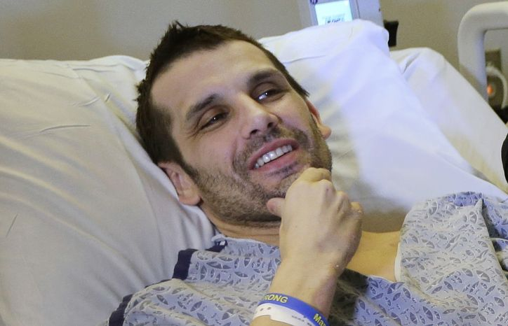 ** FILE ** Marc Fucarile smiles while speaking with reporters at the Massachusetts General Hospital in Boston on Thursday, May 9, 2013. Mr. Fucarile, who lost a leg in the Boston Marathon explosions, was released from the Spaulding Rehabilitation Hospital on Wednesday, July 24, 2013, exactly 100 days after the attack,