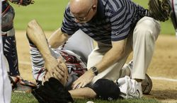 Atlanta Braves' Tim Hudson is helped by a trainer after being injured on a play at first base during the eighth inning of a baseball game against the New York Mets, Wednesday, July 24, 2013, in New York. (AP Photo/Frank Franklin II)