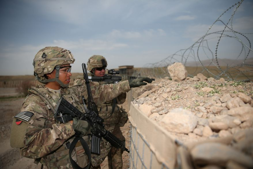 U.S. Army 1st Lt. Audrey Griffith, left, and Spc. Heidi Gerke, both with the 92nd Engineer Battalion, stand guard during a force protection exercise at Forward Operating Base Hadrian in Uruzgan province, Afghanistan, March 18, 2013. (DoD courtesy photo by U.S. Army/Released)
