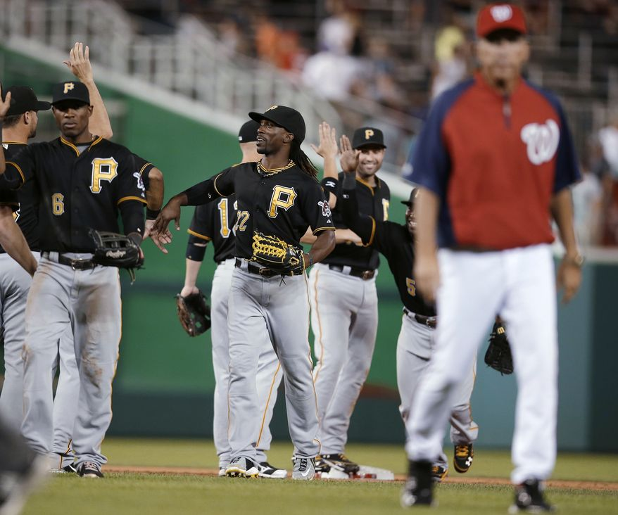 Washington Nationals manager Davey Johnson walks off the field after a blown call ended his team's comeback and sealed a 4-2 loss to the Pittsburgh Pirates. (Associated Press photo)