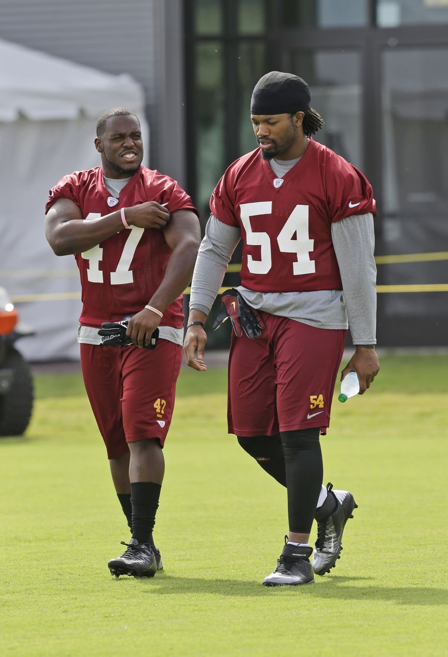 Washington Redskins Washington Redskins linebacker Jeremy Kimbrough(47) and linebacker Darryl Tapp (54) walk on the field as they begin their training camp at the NFL football teams new practice facility in Richmond, Va. Thursday, July 25, 2013. (AP Photo/Steve Helber)