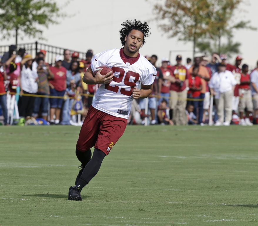 Washington Redskins Washington Redskins running back Roy Helu Jr. (29) runs a route as they begin their training camp at the NFL football teams new practice facility in Richmond, Va. Thursday, July 25, 2013. (AP Photo/Steve Helber)