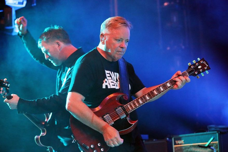 Bernard Sumner of New Order performs at Chastain Park Amphitheatre on Sunday, July 21, 2013, in Atlanta. (Photo by Robb D. Cohen/RobbsPhotos/Invision/AP)
