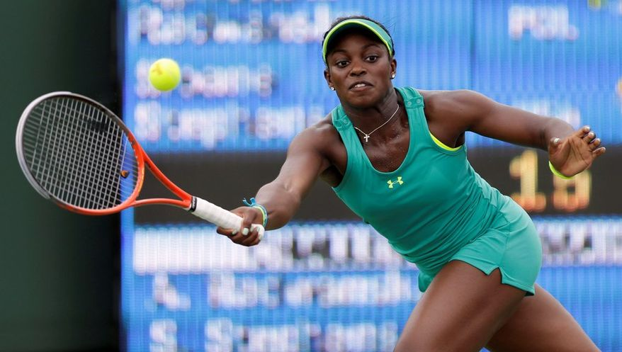 Sloane Stephens returns to Agnieszka Radwanska, of Poland, during the Sony Open tennis tournament in Key Biscayne, Fla.,  Monday, March 25, 2013. (AP Photo/Alan Diaz)