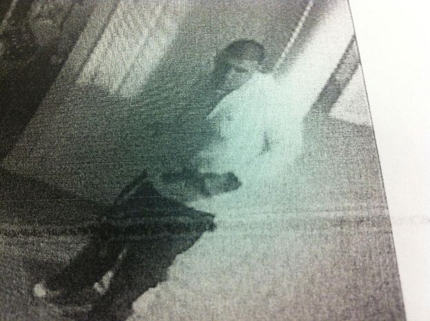 Aaron Hernandez captured on his on home surveillance video carrying what appears to be a