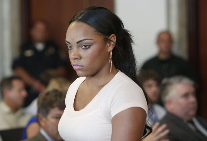 Shayanna Jenkins, fiancee of former New England Patriots NFL football tight end Aaron Hernandez, arrives at Attleboro District Courtroom, on Wednesday, July 24, 2013, in Attleboro, Mass. Hernandez has pleaded not guilty to murder in the death of Odin Lloyd. Hernandez was in court for what was supposed to be a probable cause hearing, but prosecutors said the grand jury is still considering the evidence against him. A judge rescheduled the probable cause hearing for Aug. 22, after considering defense objections to a delay. (AP Photo/Bizuayehu Tesfaye)