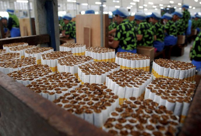 Clove cigarettes are bundled together at a factory in Kudus, Central Java, Indonesia, Thursday, July 25, 2013. Indonesia is the fifth-largest cigarette producing market, with an industry that employs millions. (AP Photo)