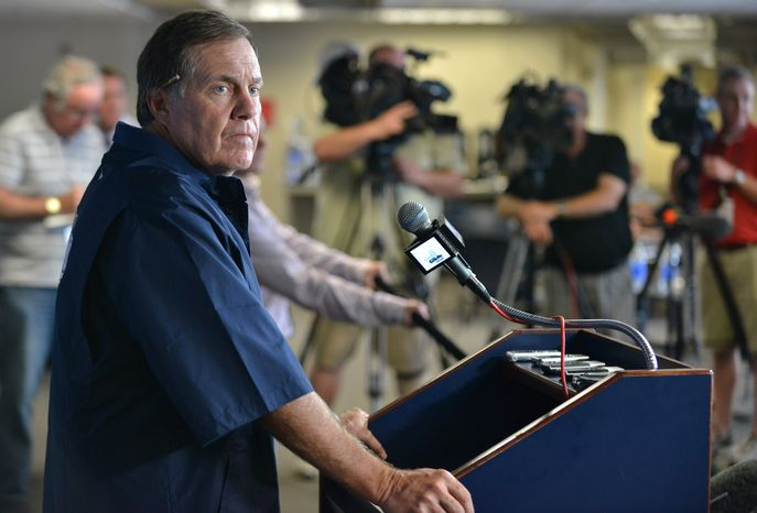 Patriots head coach Bill Belichick reacts to a reporter's question  at Gillette Stadium, in Foxborough, Mass., Wednesday, July 24, 2013, during his first news conference since arrest of former player Aaron Hernandez.  (AP Photo/Josh Reynolds)