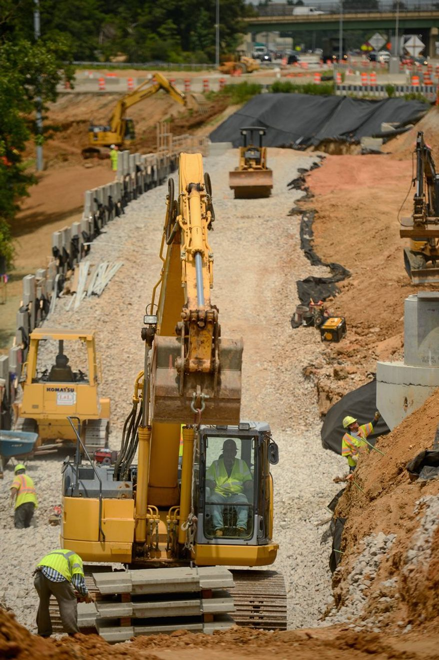 A ramp is being built from the Fairfax County Parkway to carry traffic into the new I-95 lanes in Newington. (Andrew Harnik/The Washington Times)