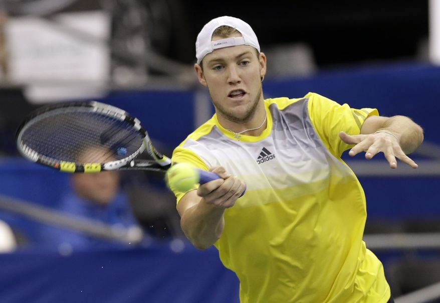 **FILE** Jack Sock returns a shot to Feliciano Lopez, of Spain, in a quarterfinal round tennis match at the U.S. National Indoor Championships on Friday, Feb. 22, 2013, in Memphis, Tenn. (AP Photo/Mark Humphrey)