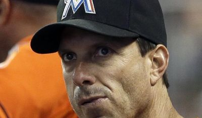 Miami Marlins hitting coach Tino Martinez looks from the dugout during a baseball game against the Pittsburgh Pirates in Miami, Sunday, July 28, 2013. Martinez has resigned after players complained he verbally abused them. (AP Photo/Alan Diaz)