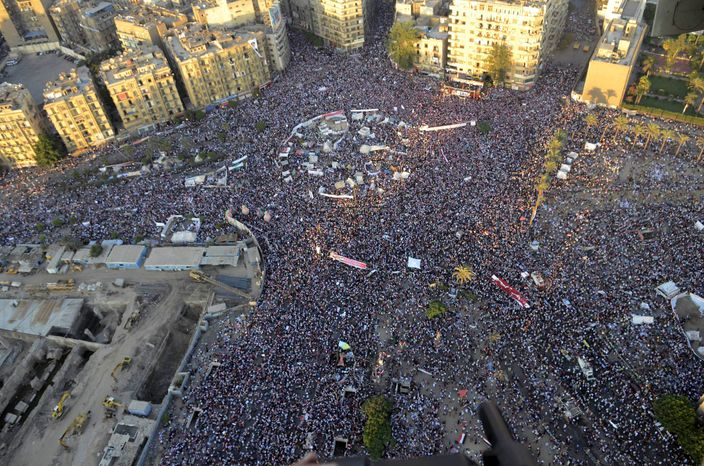 Opponents of ousted Egyptian President Mohammed Morsi protest at Tahrir Square in Cairo on Friday, July 26, 2013. Security forces clashed with Mr. Morsi's supporters early Saturday in the country's bloodiest incidence of violence since the military deposed him. (AP Photo/Hossam Diab, Egyptian army)