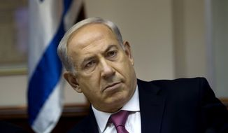 "Israeli Prime Minister Benjamin Netanyahu attends the weekly Cabinet meeting in Jerusalem on Sunday, July 28, 2013. Mr. Netanyahu urged his skeptical coalition partners Sunday to agree to free Palestinian prisoners as part of U.S efforts to resume peace talks, calling the deal a ""tough decision"" that he took for the good of the country. (AP Photo/Ronen Zvulun, Pool)"