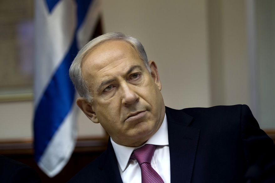 """Israeli Prime Minister Benjamin Netanyahu attends the weekly Cabinet meeting in Jerusalem on Sunday, July 28, 2013. Mr. Netanyahu urged his skeptical coalition partners Sunday to agree to free Palestinian prisoners as part of U.S efforts to resume peace talks, calling the deal a """"tough decision"""" that he took for the good of the country. (AP Photo/Ronen Zvulun, Pool)"""
