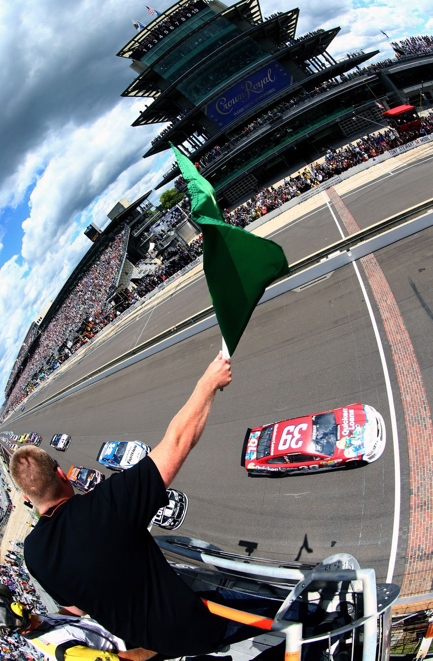 Sprint Cup Series driver Ryan Newman leads the field to the green flag to start the Brickyard 400 at Indianapolis Motor Speedway, Sunday, July 28, 2013, in Indianapolis. (AP Photo/NASCAR, Tom Pennington, Pool)