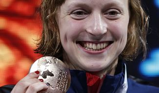Katie Ledecky of the United States smiles as she holds her gold medal after winning the Women's 400m freestyle final at the FINA Swimming World Championships in Barcelona, Spain, Sunday, July 28, 2013. (AP Photo/Michael Sohn)
