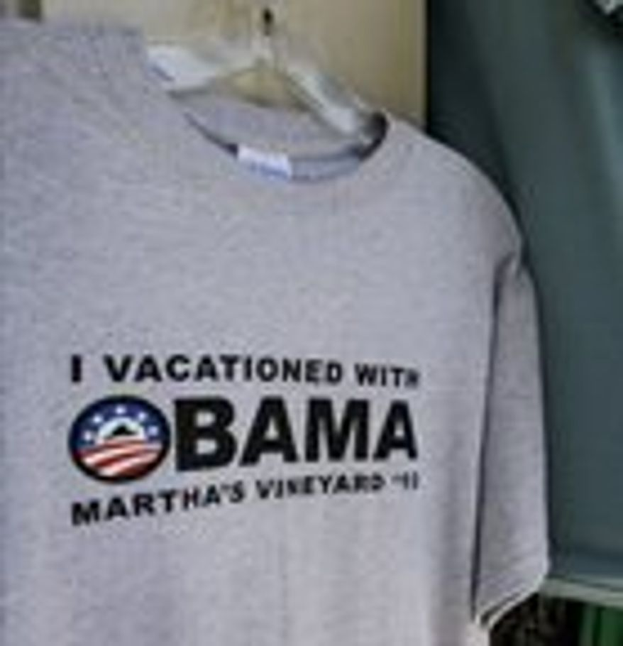 ** FILE ** President Obama went to Martha's Vineyard, and all I got was this lousy T-shirt. (Associated Press)